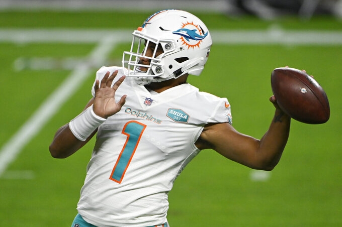 Miami Dolphins quarterback Tua Tagovailoa (1) warms up before an NFL football game against the Las Vegas Raiders, Saturday, Dec. 26, 2020, in Las Vegas. (AP Photo/David Becker)