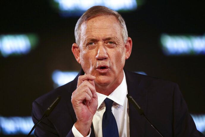 FILE - In this Tuesday, Jan. 29, 2019 file photo, former Israeli Chief of Staff Benny Gantz speaks at the official launch of his election campaign in Tel Aviv, Israel. The Israeli Justice Ministry said Monday, Feb. 11, 2019, that the government has asked a Dutch court to dismiss war crimes allegations against Benny Gantz, an ex-military chief who is challenging Prime Minister Benjamin Netanyahu in April elections. A Dutch-Palestinian man originally from the Gaza Strip is suing Gantz and Israel's former air force chief, Amir Eshel, for their roles in an airstrike on his family's home that killed six relatives. (AP Photo/Oded Balilty, File)