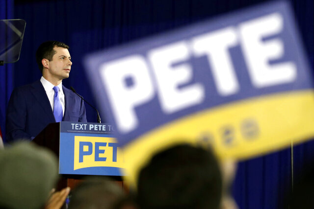 FILE - In this Feb. 11, 2020 file photo, Democratic presidential candidate former South Bend, Ind., Mayor Pete Buttigieg pauses as he speaks to supporters at a primary night election rally in Nashua, N.H. Buttigieg's presidential candidacy, though ending far short of its goal, will likely go down in history books as a success: proof of the remarkable advances made by LGBT Americans in their quest for equality and acceptance.  (AP Photo/Mary Altaffer)