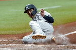 New York Yankees' Gio Urshela scores on a sacrifice fly by DJ LeMahieu off Tampa Bay Rays starting pitcher Michael Wacha during the fifth inning of a baseball game Wednesday, July 28, 2021, in St. Petersburg, Fla. (AP Photo/Chris O'Meara)