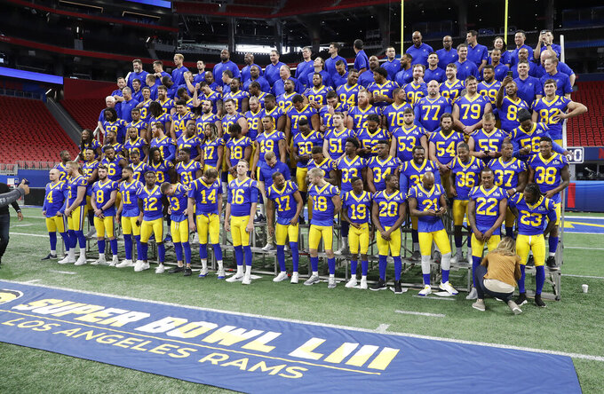 The Los Angeles Rams prepare to take a team photo during walkthrough at the Mercedes Benz Stadium for the NFL Super Bowl 53 football game against the New England Patriots, Saturday, Feb. 2, 2019, in Atlanta. (AP Photo/John Bazemore)