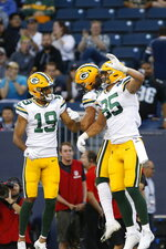 Green Bay Packers' Equanimeous St. Brown (19), Jake Kumerow and Robert Tonyan (85) celebrate Kumerow's touchdown against the Oakland Raiders during the first half of an NFL preseason football game Thursday, Aug. 22, 2019, in Winnipeg, Manitoba. (John Woods/The Canadian Press via AP)