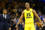 Marquette's Koby McEwen (25) reacts during the second half of an NCAA college basketball game against Butler, Sunday, Feb. 9, 2020, in Milwaukee. (AP Photo/Aaron Gash)