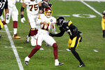 Washington Football Team quarterback Alex Smith (11) gets off a pass before he is hit by Pittsburgh Steelers safety Marcus Allen (27) during the first half of an NFL football game in Pittsburgh, Monday, Dec. 7, 2020. (AP Photo/Barry Reeger)