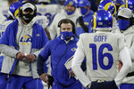 Los Angeles Rams head coach Sean McVay, center, talks to quarterback Jared Goff during the first half of an NFL divisional playoff football game against the Green Bay Packers, Saturday, Jan. 16, 2021, in Green Bay, Wis. (AP Photo/Morry Gash)