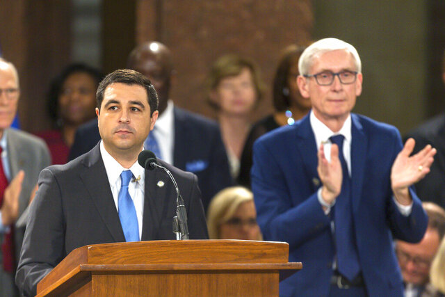 FILE - In this Jan. 7, 2019 file photo, Wisconsin Attorney General Josh Kaul speaks during his address at the inauguration of Gov. Tony Evers, right, at the state Capitol in Madison, Wis. The conservative-controlled Wisconsin Supreme Court has upheld Republican-authored lame-duck laws that curtailed the powers of the incoming Democratic attorney general. The ruling Thursday, July 9, 2020 rejected arguments that the laws were unconstitutional, giving Republican yet another victory. (AP Photo/Andy Manis, File)