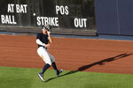 New York Yankees right fielder Aaron Judge fields a fly ball hit by Kyle Higashioka during an intrasquad baseball game Wednesday, July 15, 2020, at Yankee Stadium in New York. (AP Photo/Kathy Willens)
