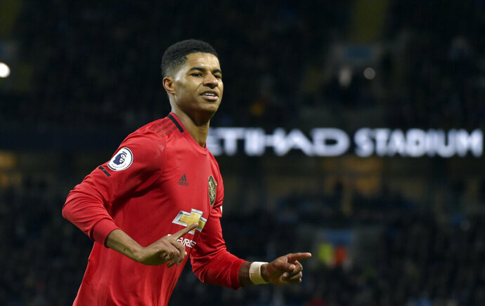 Manchester United's Marcus Rashford celebrates after scoring his side's opening goal from the penalty spot during the English Premier League soccer match between Manchester City and Manchester United at Etihad stadium in Manchester, England, Saturday, Dec. 7, 2019. (AP Photo/Rui Vieira)