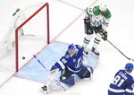 Tampa Bay Lightning goaltender Andrei Vasilevskiy (88) makes a save as Dallas Stars left wing Jamie Benn (14) looks on during second-period NHL Stanley Cup finals hockey action in Edmonton, Alberta, Saturday, Sept. 19, 2020. (Jason Franson/The Canadian Press via AP)