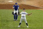 Los Angeles Dodgers starting pitcher Julio Urias celebrates their win against the Atlanta Braves in Game 7 of a baseball National League Championship Series Sunday, Oct. 18, 2020, in Arlington, Texas. (AP Photo/Sue Ogrocki)