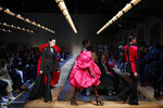 Models wear creations as part of the Alexander McQueen ready to wear Fall-Winter 2019-2020 collection, that was presented in Paris, Monday, March 4, 2019. (AP Photo/Francois Mori)