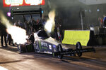 In this photo provided by the NHRA, Brittany Force takes part in Top Fuel qualifying Friday, Oct. 8, 2021, at the Texas NHRA FallNationals drag races at Texas Motorplex in Ennis, Texas. (NHRA via AP)