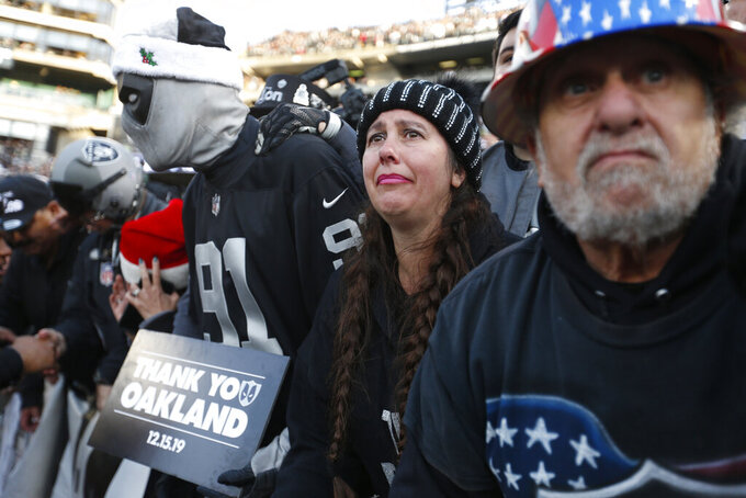 "Oakland Raiders fans in ""The Black Hole"" watch their team walk off the field at the end of an NFL football game against the Jacksonville Jaguars n Oakland, Calif., Sunday, Dec. 15, 2019. (AP Photo/D. Ross Cameron)"