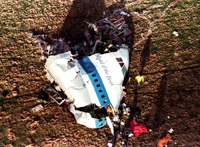 """FILE - In this Dec. 22, 1988 file photo the nose section of Pan Am Flight 103, a 747 airliner dubbed """"The Maid of the Sea,"""" lies in a field outside the village of Lockerbie, Scotland.  The United Kingdom has suffered its worst ever civilian loss of life since World War II, because of the coronavirus, with some 100,000 taken by the pandemic, a fearsome foe whose defeat is still some time away. (AP Photo/Martin Cleaver, File)"""