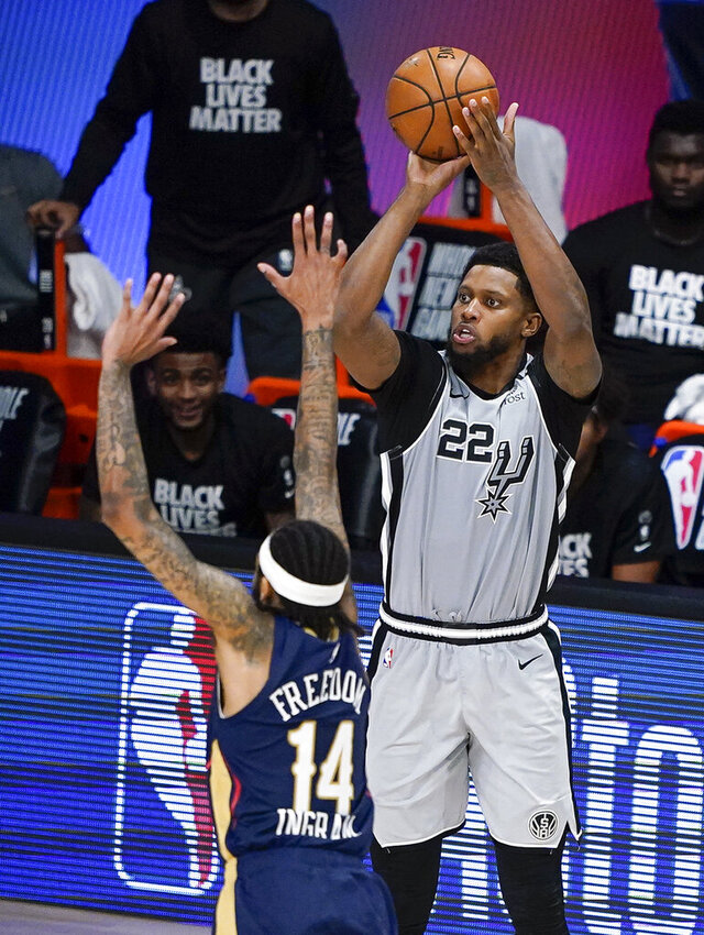San Antonio Spurs forward Rudy Gay (22) takes a shot over New Orleans Pelicans forward Brandon Ingram (14) during the second half of an NBA basketball game, Sunday, Aug. 9, 2020, in Lake Buena Vista, Fla. (AP Photo/Ashley Landis, Pool)