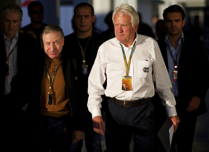 FILE - In this Oct. 10, 2014, file photo, Charlie Whiting, FIA Race Director, right, and FIA President Jean Todt, left, arrive for a news conference at the 'Sochi Autodrom' Formula One circuit , in Sochi, Russia.  The governing body for international auto racing says its Formula One director Whiting has died from a pulmonary embolism. He was 66. The FIA issued a statement Thursday, March 14, saying Whiting died in Melbourne, where the season-opening Australian Grand Prix will be raced on Sunday. (AP Photo/Pavel Golovkin, File)