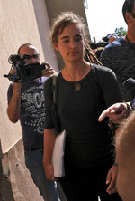 Sea-Watch3 German captain Carola Rackete arrives for questioning in court in the southern Sicilian town of Agrigento, Italy, Thursday, July 18, 2019. Rackete, who forced a government block docking at an Italian port after rescuing migrants, faces questioning by Italian prosecutors over allegedly aiding illegal immigration. (Pasquale Claudio Montana Lampo/ANSA via AP)