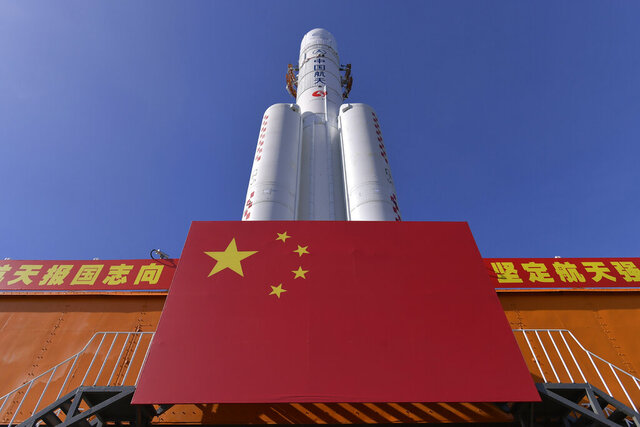 FILE - In this July 17, 2020, file photo released by China's Xinhua News Agency, a Long March-5 rocket is seen at the Wenchang Space Launch Center in south China's Hainan Province. China on Tuesday, Nov. 17, 2020, moved the massive rocket into place in preparation for launching a mission to bring back materials from the moon for the first time in four decades. (Zhang Gaoxiang/Xinhua via AP, File)