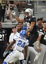 Central Florida wide receiver Tre Nixon, right, is unable to make a reception as he defended by Memphis defensive back Tito Windham (24) during the first half of the American Athletic Conference championship NCAA college football game, Saturday, Dec. 1, 2018, in Orlando, Fla. (AP Photo/John Raoux)