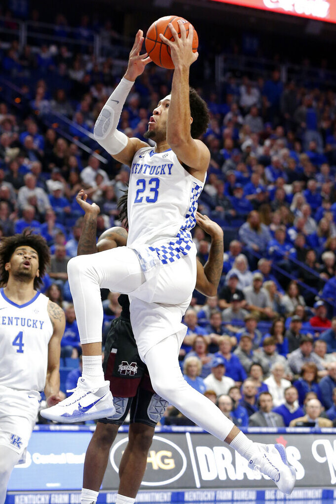Kentucky's EJ Montgomery shoots near Mississippi State's Nick Weatherspoon during the first half of an NCAA college basketball game in Lexington, Ky., Tuesday, Feb. 4, 2020. (AP Photo/James Crisp)