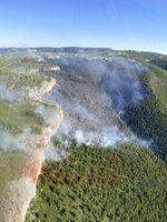 This Tuesday, June 15, 2021, aerial photo released by the Bureau of Indian Affairs shows the Buffalo Pasture fire burning south of St. Xavier, Mont., on the Crow Indian Reservation. Record-high temperatures and gusting winds stoked a rapid expansion of major fires across central and eastern Montana. On the Crow Reservation, officials reported a new fire in the Bighorn Mountains near the Montana-Wyoming border. The fire was burning in steeply sided Little Bull Elk Canyon, with flames up to 150 feet (46 meters) high that threatened to spread the blaze rapidly, officials said. (Karl Big Hair/Bureau of Indian Affairs via AP)