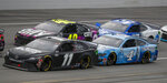 Denny Hamlin (11) takes the inside lane in front of Kevin Harvick (4) as Jimmie Johnson (48) keeps up during a NASCAR Cup Series auto race at Talladega Superspeedway in Talladega Ala., Monday, June 22, 2020. (AP Photo/John Bazemore)