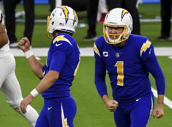 Kicker Mike Badgley #4 celebrates with punter Ty Long #1 of the Los Angeles Chargers after kicking the game winning 43 yard field goal to defeat the Atlanta Falcons 20-17 during a NFL football game at SoFi Stadium in Inglewood on Sunday, December 13, 2020. Los Angeles Chargers won 20-17. (Keith Birmingham/The Orange County Register via AP)