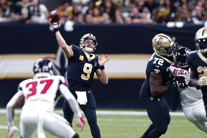 New Orleans Saints quarterback Drew Brees (9) passes in the first half of an NFL football game against the Atlanta Falcons in New Orleans, Sunday, Nov. 10, 2019. (AP Photo/Butch Dill)