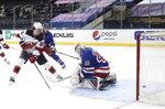 New Jersey Devils' Jack Hughes (86) scores against New York Rangers goalie Alexandar Georgiev during the second period of an NHL hockey game Tuesday, Jan. 19, 2021, in New York. (Bruce Bennett/Pool Photo via AP)