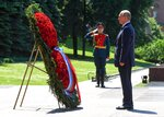 Russian President Vladimir Putin stands during a minute of silence in memory of those killed during WWII as he takes part in a wreath laying ceremony at the Tomb of Unknown Soldier in Moscow, Russia, Monday, June 22, 2020, marking the 79th anniversary of the Nazi invasion of the Soviet Union. (Alexei Nikolsky, Sputnik, Kremlin Pool Photo via AP)