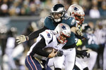New England Patriots' Tom Brady (12) is tackled by Philadelphia Eagles' Nate Gerry (47) during the second half of an NFL football game, Sunday, Nov. 17, 2019, in Philadelphia. (AP Photo/Michael Perez)