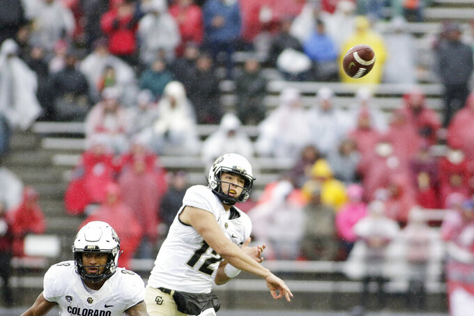 Colorado quarterback Steven Montez (12) throws a pass during the first half of an NCAA college football game against Washington State in Pullman, Wash., Saturday, Oct. 19, 2019. (AP Photo/Young Kwak)