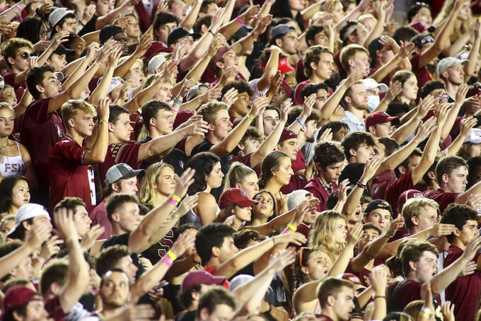 Florida State fans, almost none of whom were complying with the mandatory mask mandate, do The Chop during an NCAA college football game against Notre Dame Sunday, Sept. 5, 2021, in Tallahassee, Fla. Notre Dame won 41-38 in overtime, (AP Photo/Phil Sears)