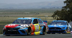 Kyle Busch, left, leads Ryan Blaney (12) during a NASCAR Sprint Cup Series auto race Sunday, June 23, 2019, in Sonoma, Calif. (AP Photo/Ben Margot)