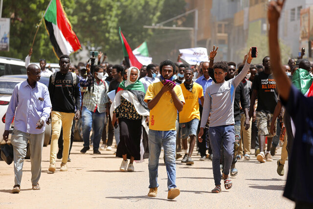 Sudanese protesters march to the Cabinet's headquarters in the capital, Khartoum, Sudan, Monday, Aug. 17, 2020. The protesters returned to the streets Monday to pressure transitional authorities for more reforms, a year after a power-sharing deal between the pro-democracy movement and the generals. (AP Photo/Marwan Ali)
