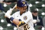 Milwaukee Brewers' Keston Hiura is hit by a pitch during the fifth inning of a baseball game against the Pittsburgh Pirates Friday, April 16, 2021, in Milwaukee. (AP Photo/Morry Gash)