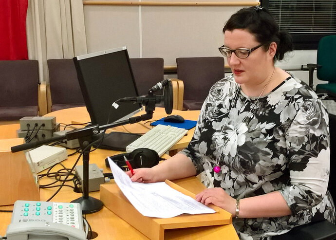 In this photo taken on Dec. 21 2017, announcer Laura Nissinen prepares to read the news in Latin for the Nuntii Latini program at the Radio1 studio of the Finnish national broadcaster YLE in Helsinki, Finland.  After 28 years of weekly radio broadcasts, Finnish national broadcaster YLE was set to shut down a Latin news program with a small but passionate following. But after loud protests from listeners in dozens of countries, makers of