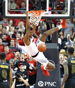 Louisville center Steven Enoch (23) dunks as Vermont guard Stef Smith (0) and forward Ra Kpedi (15) watch during the first half of an NCAA college basketball game in Louisville, Ky., Friday, Nov. 16, 2018. Louisville won 86-78. (AP Photo/Timothy D. Easley)