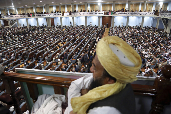 Delegates attend the first day of the Afghan Loya Jirga meeting in Kabul, Afghanistan, Monday, April 29, 2019.  Afghanistan's president Ashraf Ghani opened the Loya Jirga grand council on Monday with more than 3,200 prominent Afghans attending to seek an agreed common approach for future peace talks with the Taliban, but the gathering may further aggravate divisions within the U.S.-backed government. (AP Photo/Rahmat Gul)