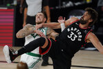 Boston Celtics' Daniel Theis, fights for position for a rebound with Toronto Raptors' Marc Gasol (33) during the second half of an NBA conference semifinal playoff basketball game Saturday, Sept. 5, 2020, in Lake Buena Vista, Fla. (AP Photo/Mark J. Terrill)