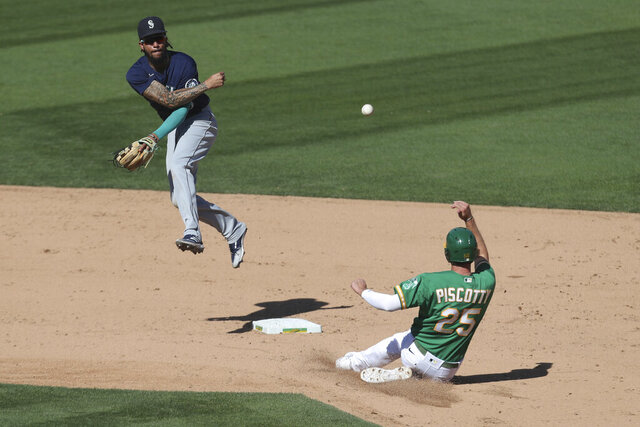 Seattle Mariners' J.P. Crawford, left, throws to first as Oakland Athletics' Stephen Piscotty slides into second on a double play hit by Jake Lamb during the seventh inning of the first baseball game of a doubleheader in Oakland, Calif., Saturday, Sept. 26, 2020. (AP Photo/Jed Jacobsohn)