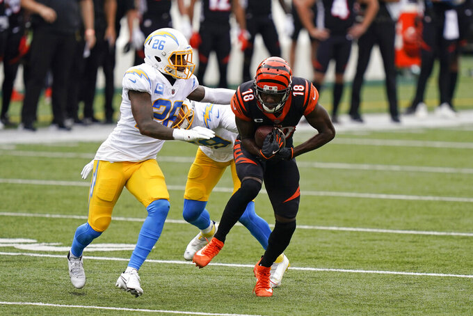 Cincinnati Bengals' A.J. Green (18) makes a catch against Los Angeles Chargers' Casey Hayward (26) during the first half of an NFL football game, Sunday, Sept. 13, 2020, in Cincinnati. (AP Photo/Bryan Woolston)