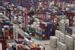 Shipping containers are seen at a port of Kwai Tsing Container Terminals in Hong Kong, Friday, May 24, 2019. Kwai Tsing Container Terminals is one of the busiest ports in the world. (AP Photo/Kin Cheung)