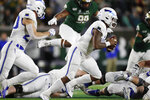 Air Force quarterback Donald Hammond III, front, runs for a short gain with Colorado State defensive lineman Ellison Hubbard in pursuit in the first half of an NCAA football game Saturday, Nov. 16, 2019 in Fort Collins, Colo. (AP Photo/David Zalubowski)