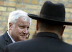 German Interior Minister Horst Seehofer arrives at a synagogue in Halle, Germany, Thursday, Oct. 10, 2019. A heavily armed assailant ranting about Jews tried to force his way into a synagogue in Germany on Yom Kippur, Judaism's holiest day, then shot two people to death nearby in an attack Wednesday that was livestreamed on a popular gaming site. (AP Photo/Jens Meyer)
