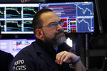 Specialist Anthony Matesic works at his post on the floor of the New York Stock Exchange, Friday, Feb. 28, 2020. Stocks are opening sharply lower on Wall Street, putting the market on track for its worst week since October 2008 during the global financial crisis. (AP Photo/Richard Drew)