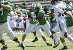 Marshall running back Brenden Knox (20) takes a handoff from quarterback Grant Wells during an NCAA college football game against Eastern Kentucky on Saturday, Sept. 5, 2020, in Huntington, W.Va. (Sholten Singer/The Herald-Dispatch via AP)