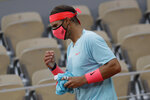 Spain's Rafael Nadal wears a face mask during a break in the first round match of the French Open tennis tournament against Egor Gerasimov of Belarus at the Roland Garros stadium in Paris, France, Monday, Sept. 28, 2020. (AP Photo/Alessandra Tarantino)