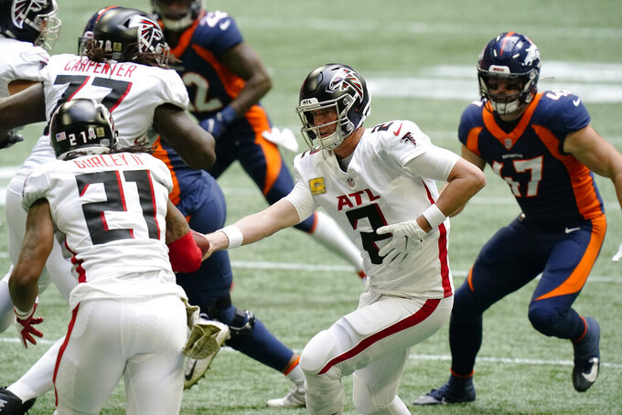 Atlanta Falcons quarterback Matt Ryan (2) hand the ball off to Atlanta Falcons running back Todd Gurley (21) against the Denver Broncos during the first half of an NFL football game, Sunday, Nov. 8, 2020, in Atlanta. (AP Photo/Brynn Anderson)