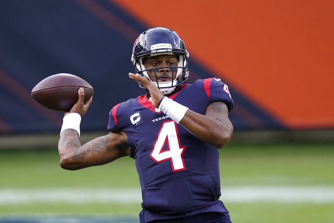 Houston Texans quarterback Deshaun Watson throws before an NFL football game against the Chicago Bears, Sunday, Dec. 13, 2020, in Chicago. (AP Photo/Charles Rex Arbogast)